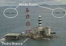Sovereignty over the strategically located island of Pedra Branca (foreground) was awarded to Singapore. Middle Rocks in the background go to Malaysia.
