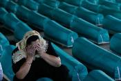 A woman froms Srebrenica mourns the death of one of up to 8,000 Bosnian Muslims who were killed in the massacre in July 1995.