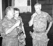 Bosnian Serb army Commander General Ratko Mladic, left, drinks a toast with Dutch UN Commander Tom Karremans, right, in Potocari, some 5 kilometers north of Srebrenica on 12 July 1995.